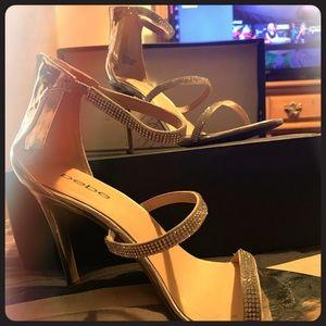 Never worn silver Bebe heels